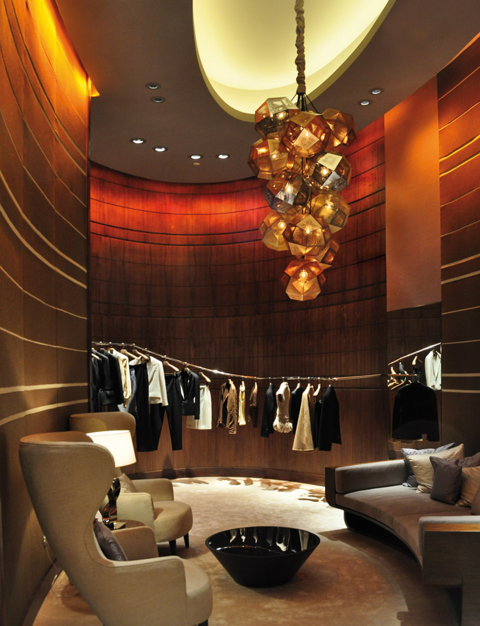 Decorative luminaires and use of colour are ways of providing visual interest and enhancing the brand. Shown is the Qela luxury goods store in Doha