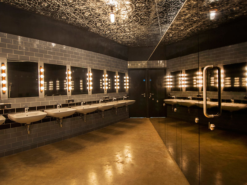 Methacrylic resin adds a warm sheen to this concrete floor inside Brooklyn Bowl at London's O2