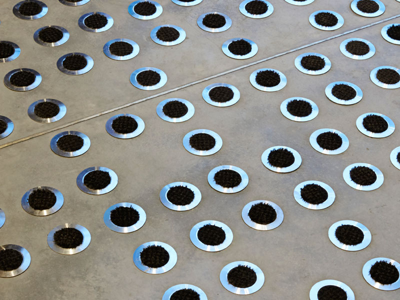 Entrance matting is elevated to an art form in this bespoke concrete floor for the Buckley Building in central London