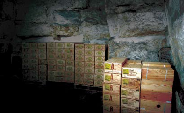 Cases of Lafite, Latour, and other top Bordeaux at Octavian Vaults' secure underground wine-storage facility in a former quarry in Corsham, Wiltshire