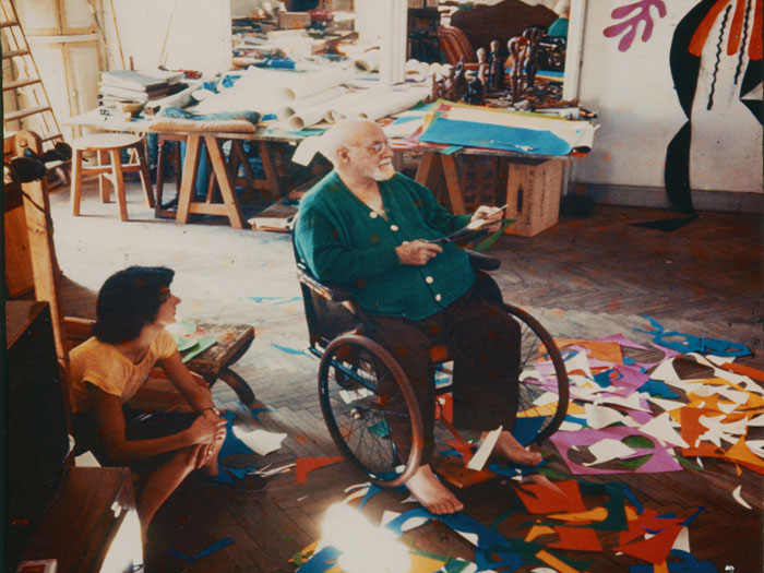 Matisse at work in his studio, using a wheelchair after an operation following a diagnosis of cancer