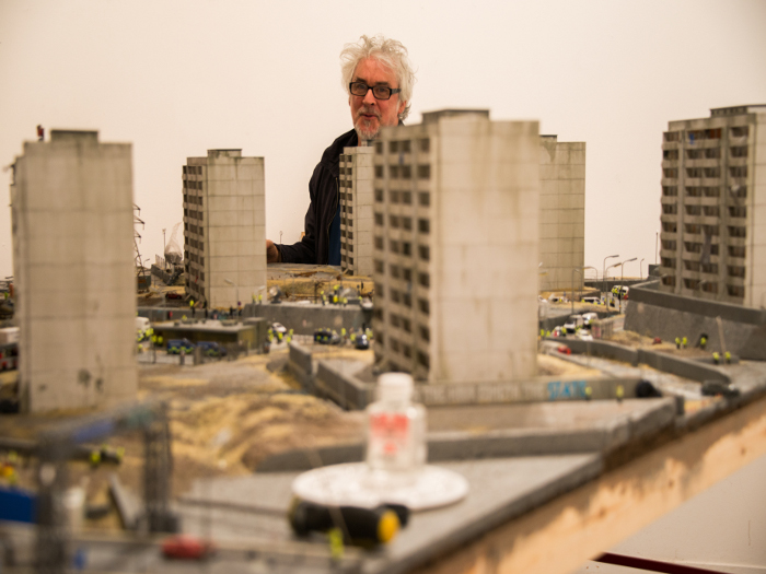 James Cauty peers through the tower blocks, which contain a cow and prancing horses among other things Photo credit: Johnny Tucker