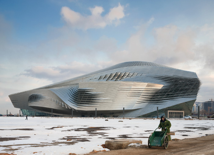 The 220m-long, 60m-high Dalian Conference Center, with a fluid envelope of steel, contains a conference and opera theatre.