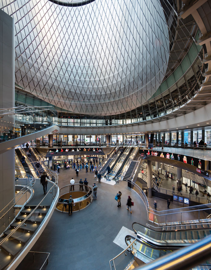Inside the Fulton Center a 16m circular skylight, called the oculus, intersects the dome. Its Sky Reflector-Net skirt (above), an artwork and independent reflective lining, catches and amplifies incoming light and daylight enough for it to penetrate two levels below ground