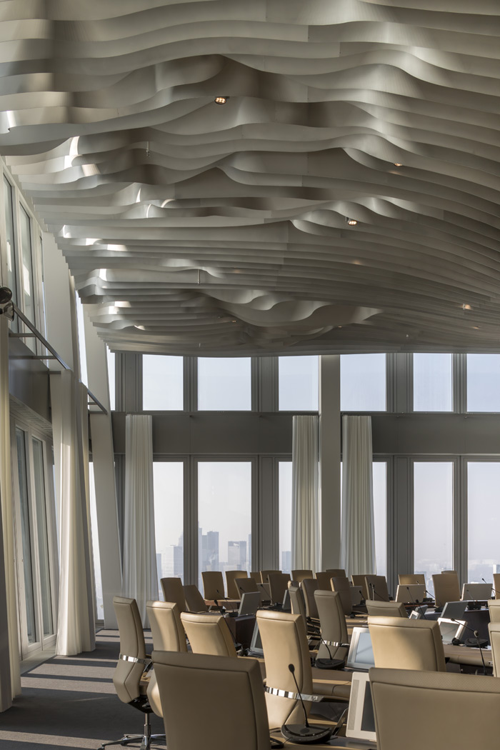 Money talks in the Council Chamber atop the South Tower. The ceiling reveals Europe from a certain angle, a window reveals a glimps of central skyscrapers