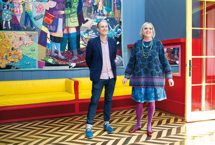 Charles Holland, of FAT Architecture, inside A House for Essex with Grayson Perry dressed as Julie. Photo Credit: Katie Hyams