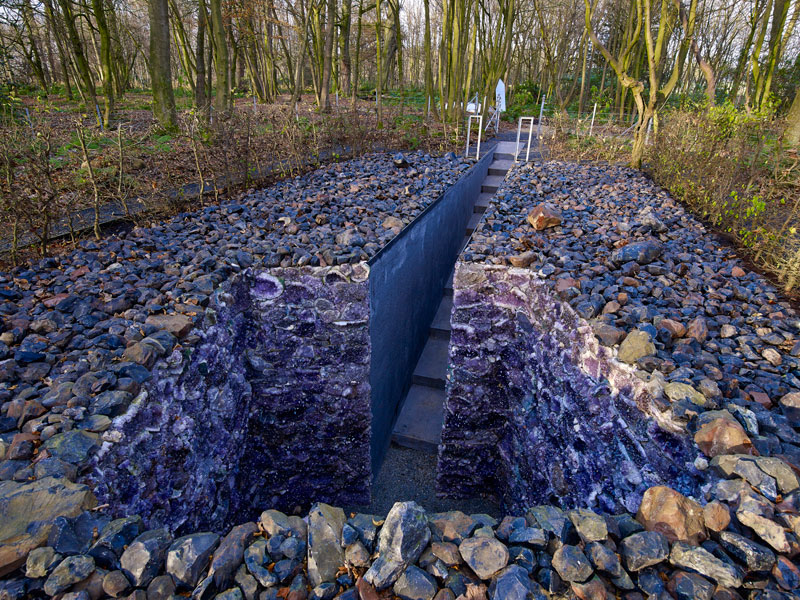 Scottish artist Anya Gallaccio's grotto of obsidian glass and Brazilian amethyst, The Light Shines Out of Me, is at the Jupiter Artland in Edinburgh. Photo Credit: J Mckenzie