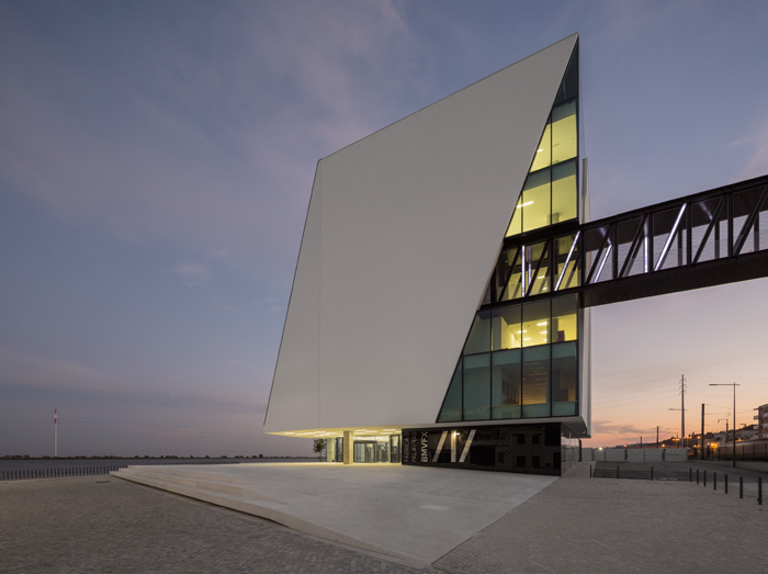The solid northern facade evokes a sail