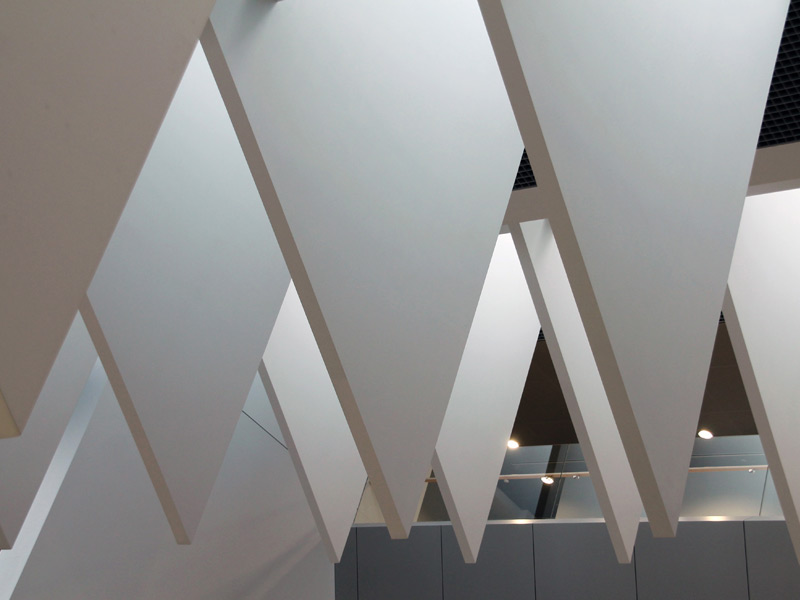 Light from skylight is channeled by triangular fins as sharps as shark's teeth. Photography Janis Dripe