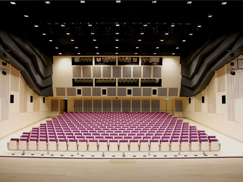 The wood-lined Auditorium, in which the first four rows of seating can be slid under the stage. Photography Janis Dripe