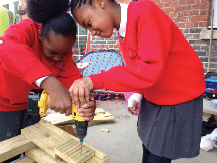 Children at Northworld Primary school take part in building thier own playground