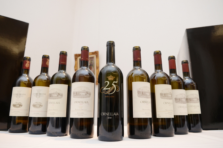 The special bottle commemorating Ornellaia's 25th anniversary vintage (2010), together with other vintages of Ornellaia and of its second wine, Le Serre Nuove