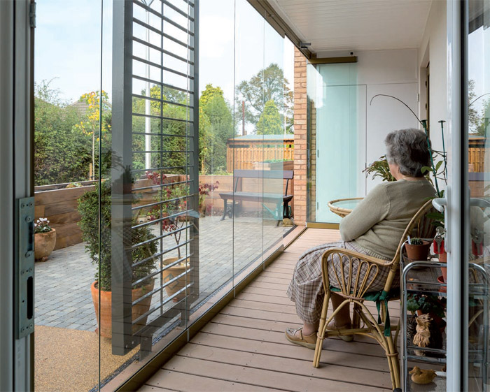 At the Pilgrim Gardens development, run by a Christian charity, each apartment has sliding glazed doors to seal off the balcony from the patio in winter