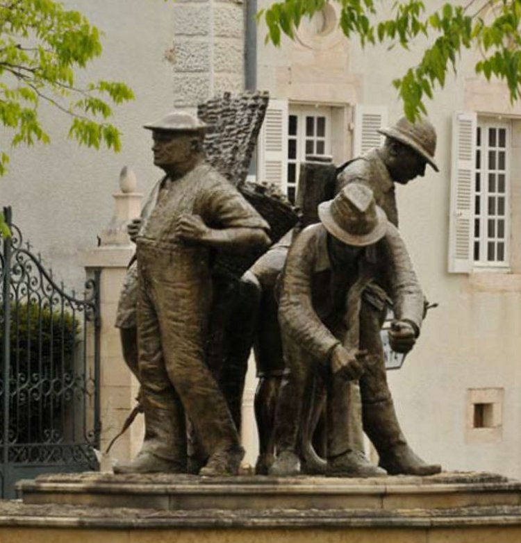 A statue of vineyard workers in Puligny-Montrachet, where two of its finest premiers crus, Le Cailleret and Les Pucelles, are among the climats considered by Norman to be of higher quality than the rest