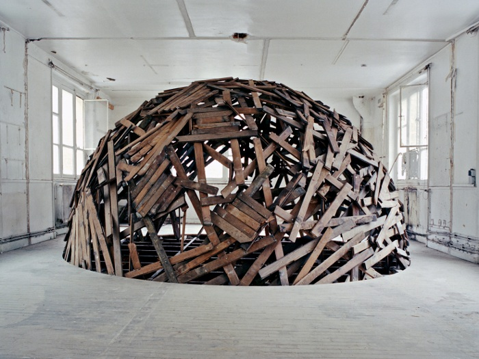 One of the most spectacular works, was Sambre's Disco Ball. After selecting two rooms as his workspace on the third and fourth floors, he drilled a large hole between them and suspended a massive sphere made of ripped-up parquet floorboards. The low wall backdrop is made of plaster and rubble recuperated from the process
