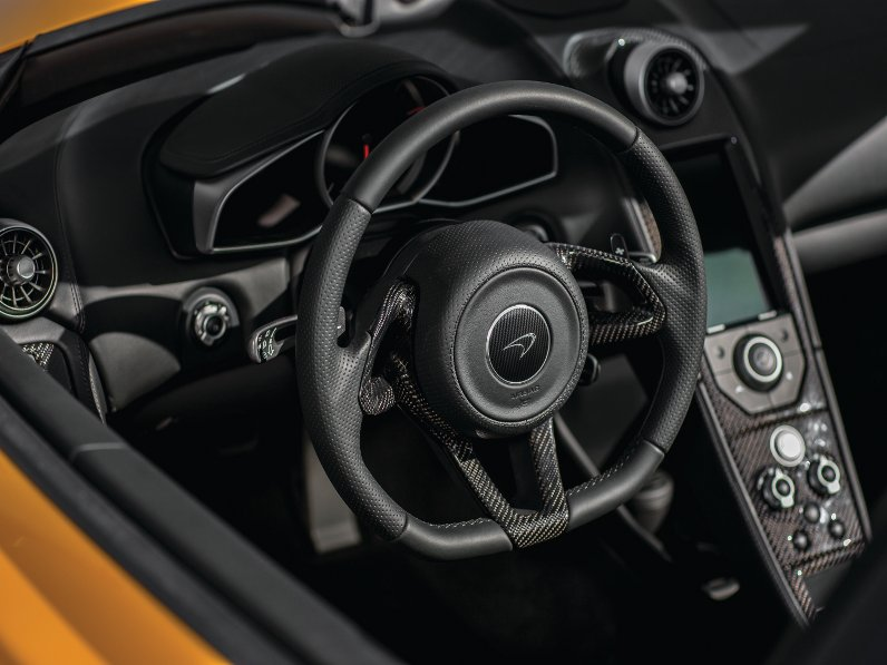 Rotary controls switch between normal, track and sport functions; change gear using the paddles behind the steering wheel