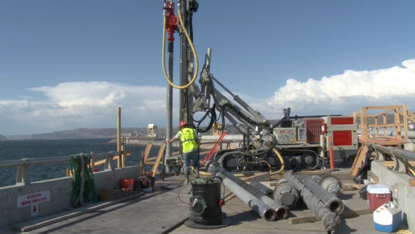 Wanapum Dam: a drill rig bores out a hole for an anchor tendon that will go from the top of the spillway into bedrock below the dam.