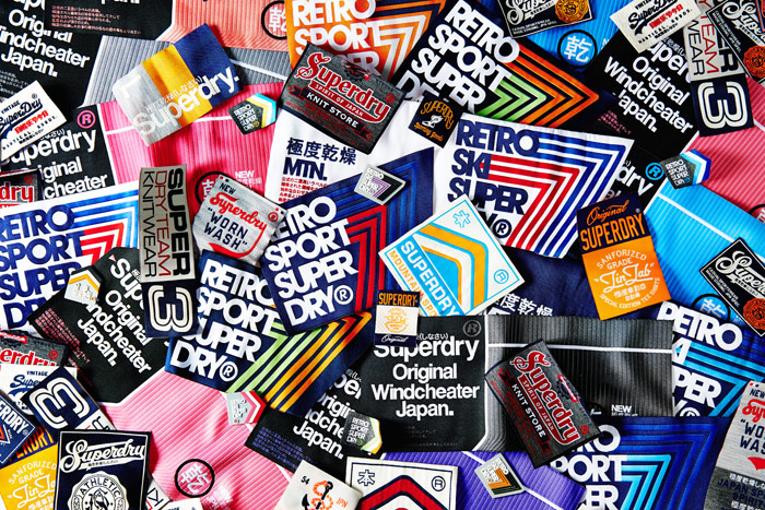 A collage of Superdry badges
