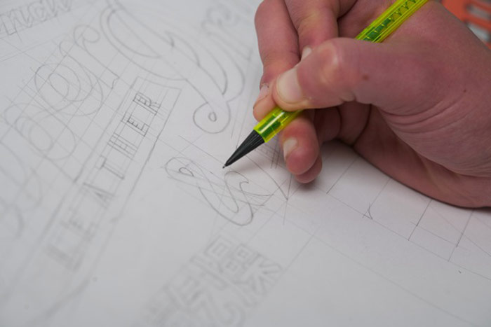Hand-drawn graphics being created for Superdry garments