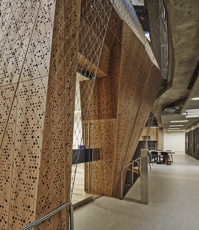 The density of perforations increases towards the base of the structure