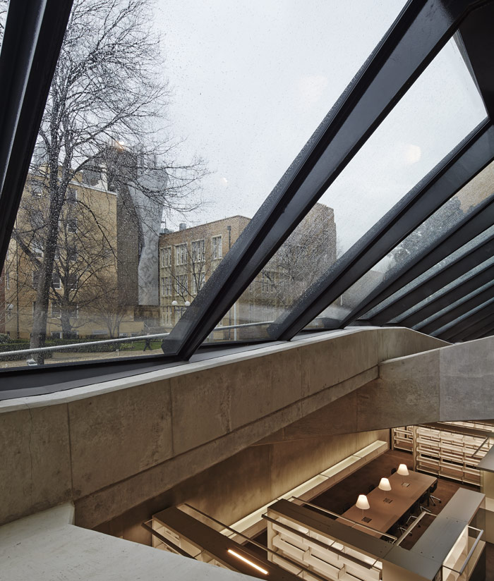 Tilted glazing lets light deep into the library below