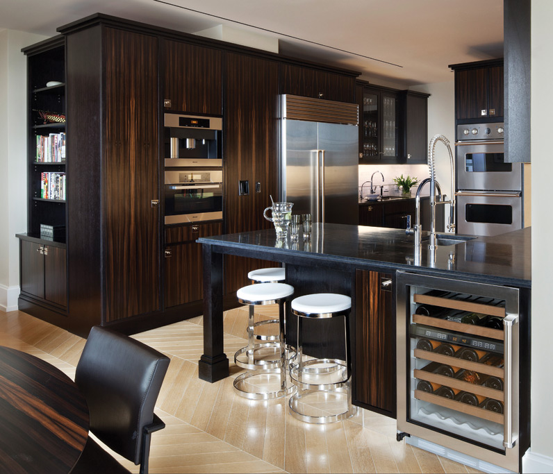 The bespoke kitchen, by Smallbone of Devizes, was designed exclusively for Walker Tower. Its richly toned macassar ebony units are framed in ebonised walnut. Photography by Tim Street Porter