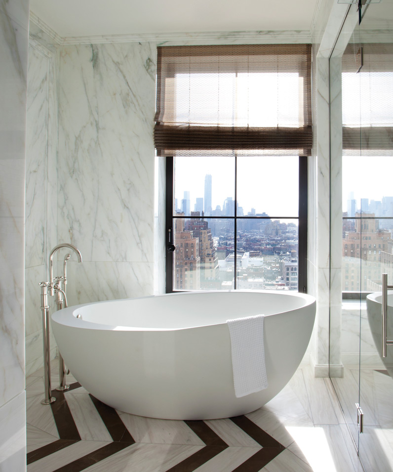 The pebblelike bath is perfectly placed to take in the skyline of manhattan; Photography by Tim Street Porter