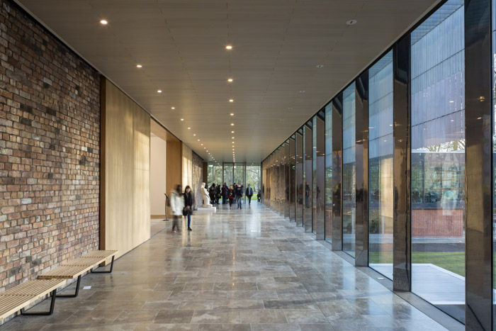 The Gallery Promenade is a composition of Purbeck stone flooring, old brick, oak, glass, steel and light