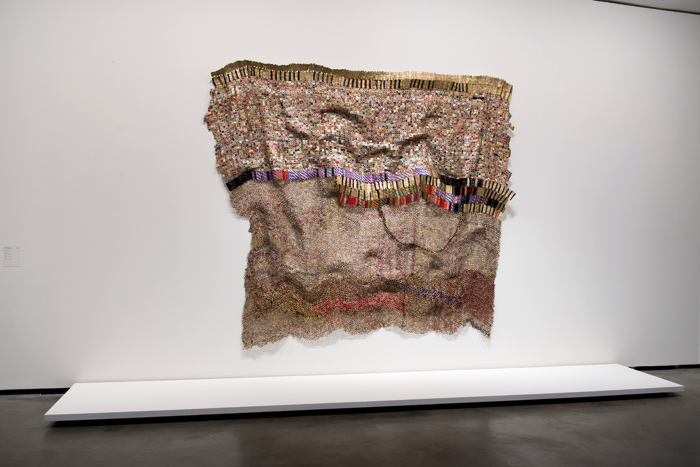 Textile made by El Anatsui from bottle tops and sweet wrappers