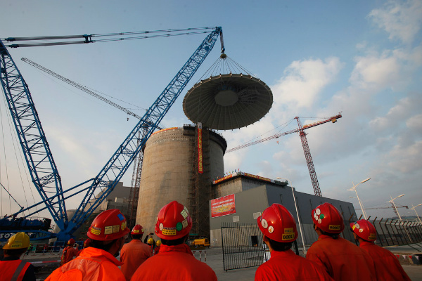 Westinghouse and its consortium team CB&I and China's SNPTC successfully set the shield building conical roof on Unit 1 of the Sanmen AP1000 on 23 November 2013 (Credit: Westinghouse)