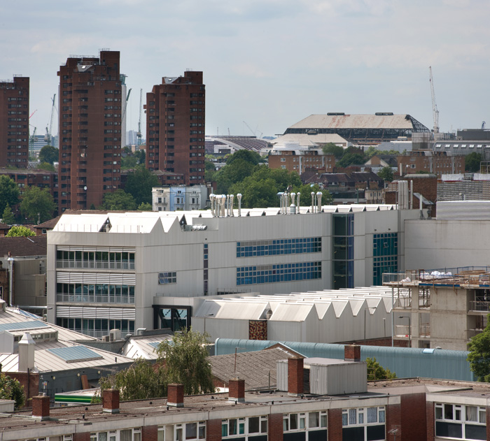 The Woo rises behind the Sackler, with the World's End Estate, by Eric Lyons and Cadbury-Brown, and C Howard Crane's Earls Court Exhibition Hall (in demolition) behind