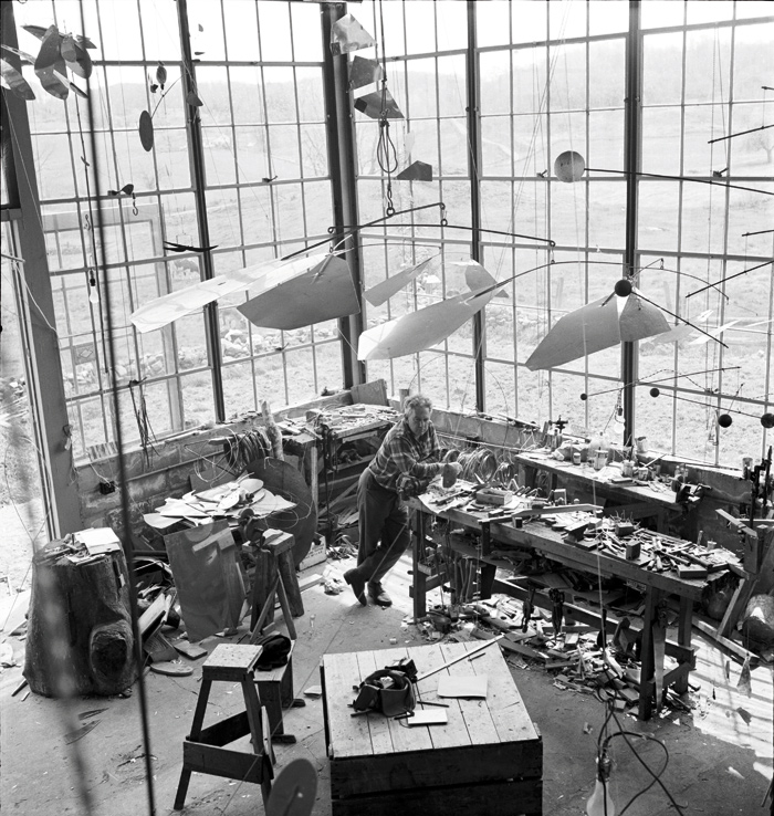 Alexander Calder in his studio in Roxbury, Connecticut in 1941. Image Credit: Photography: Herbert Matter / Courtesy Calder Foundation, New York / DACS, London
