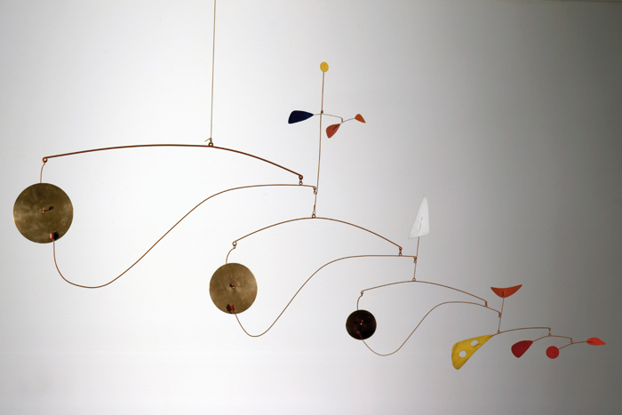 Triple Gong. Brass, sheet metal, wire and paint (c1948). Image Credit:  2015 Calder Foundation, New York / DACS, London