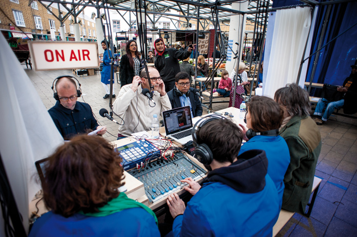 The Decorators set up a radio station to explore Chrisp Street Market's history and hidden stories (2013). Photo Credit: DOSFOTOS