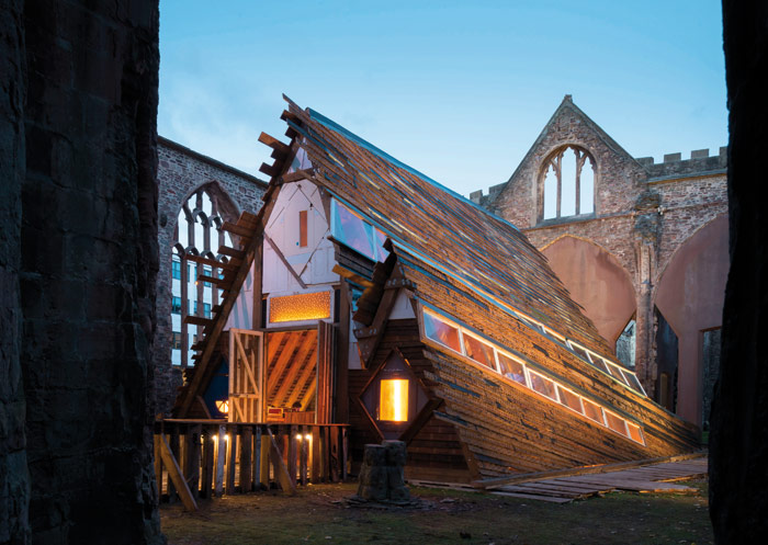 Built from repurposed materials, outside it looks as though the roof is partly collapsed, and from the inside 'just bonkers from a structural engineering point of view' says its architect. Photo Credit: Jim Stephenson