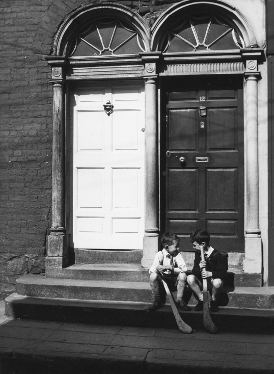 Two boys on doorstep, Kilkenny, Ireland, 1965 (c) Edwin Smith, RIBA Library Photographs Collection