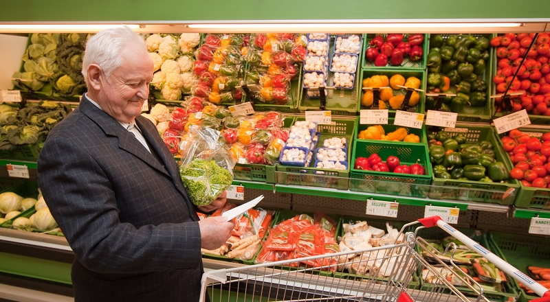 Man with trolley in supermarket