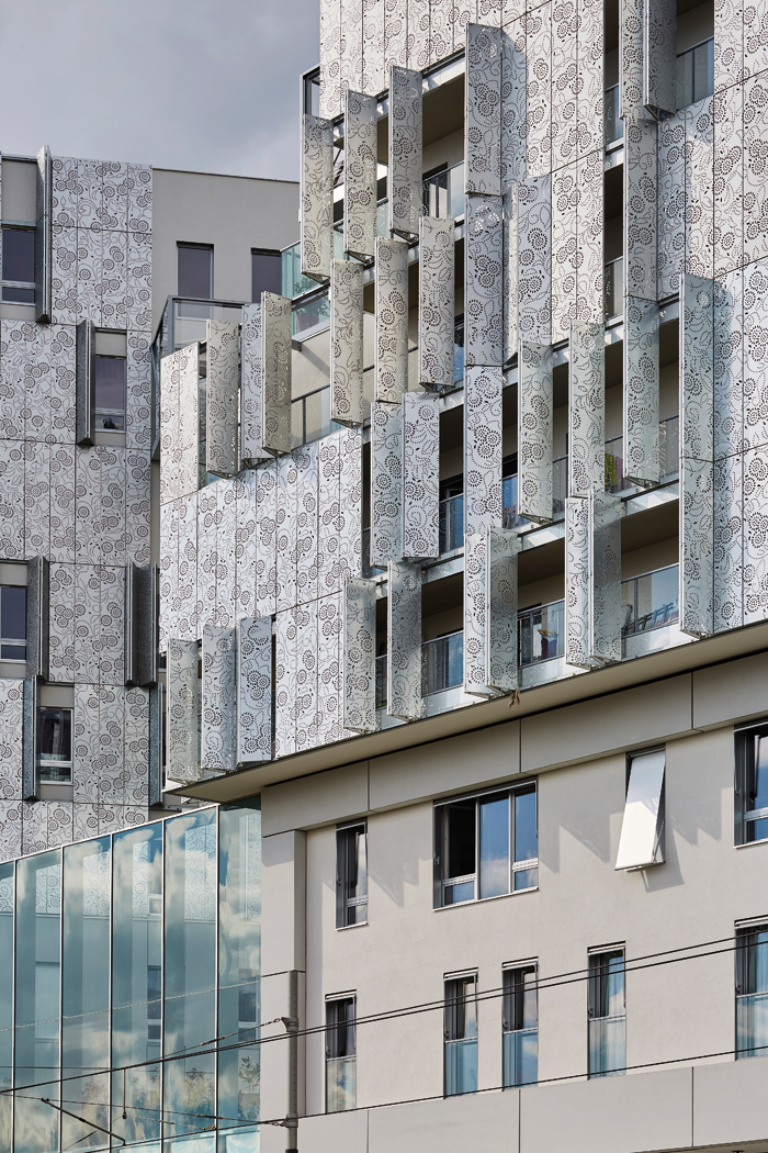 Perforated patterns distinguish the metal exterior of the Brenac & Gonzalez housing
