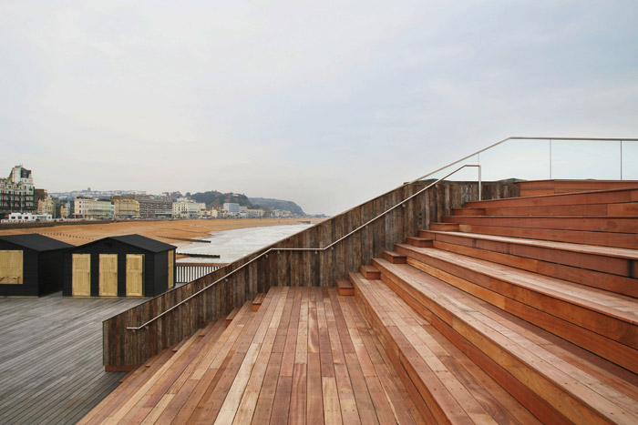 A flight of wide stairs is in eke, an African hard wood especially used for marine environments. They access the roof of the visitors centre and can double as seating for temporary events