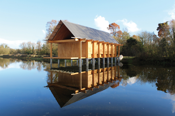 Niall McLaughlin's Fishing Hut intentionally allows sight through the salatted flooring of the water below
